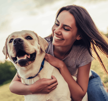 Woman with her Dog Smiling